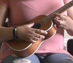 person playing the ukulele